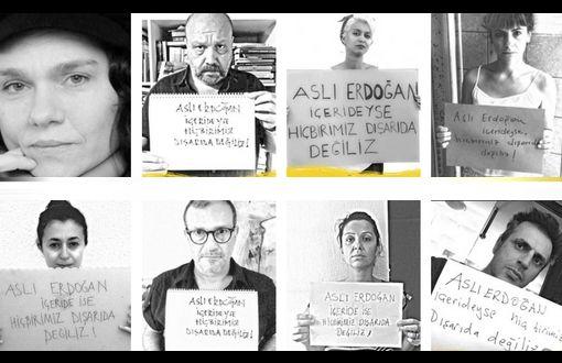 """Aslı Erdoğan arresterades 19 augusti. En social mediekampanj har inletts i protest mot gripandet av författaren och Özgür Gündem dagliga Publishing Consultant Styrelseledamot Aslı Erdoğan. De som agerar i solidaritet med Erdoğan uttrycker sitt stöd med sina bilder bär banderoller """"Ingen av oss är utanför om Aslı Erdoğan är inne""""."""