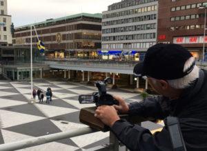 Filminspelning flaggan Sergels torg